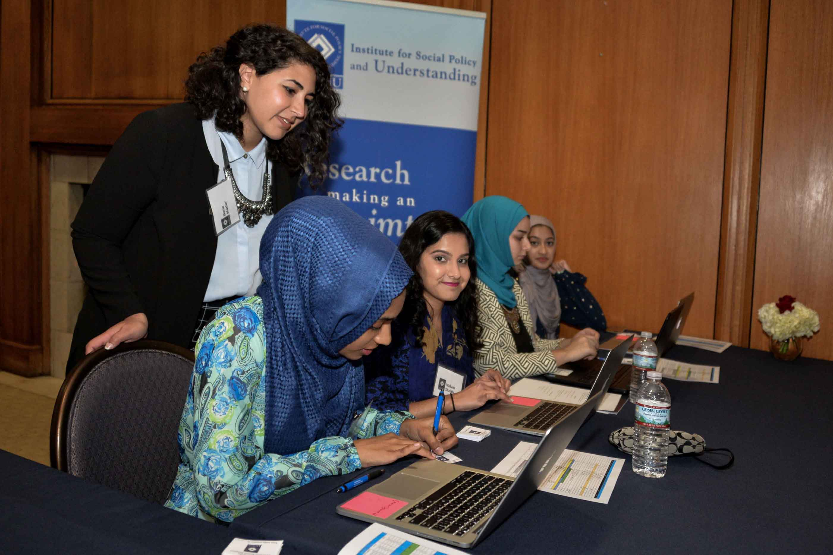 ISPU volunteers working diligently at an event check-in table