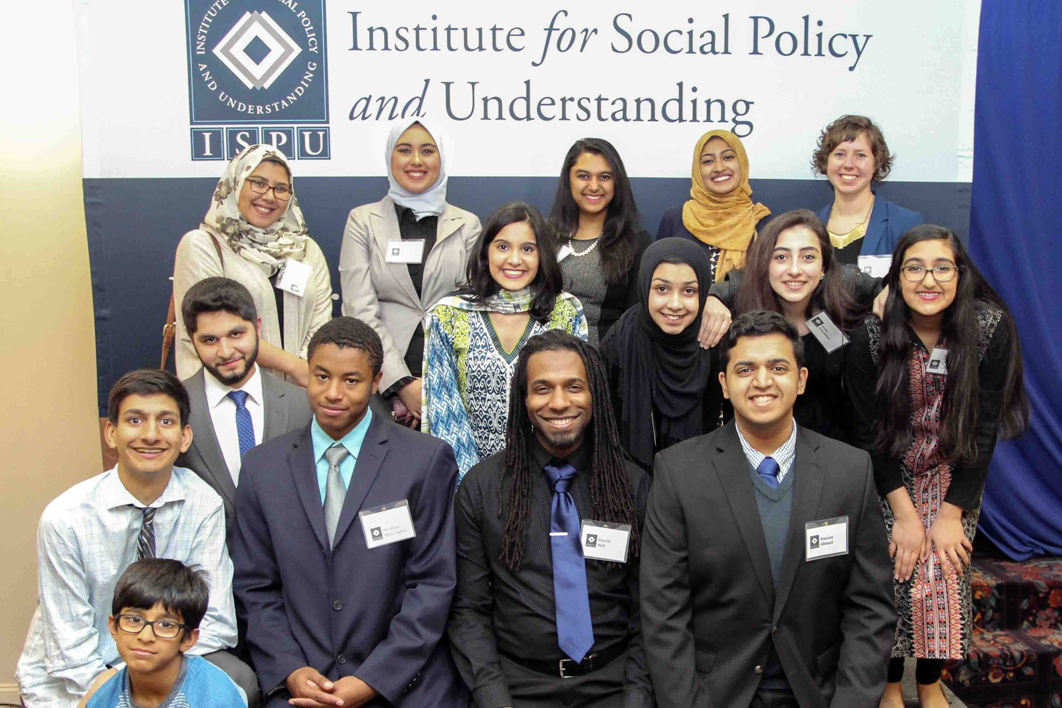 A group of young, well-dressed volunteers at an ISPU event
