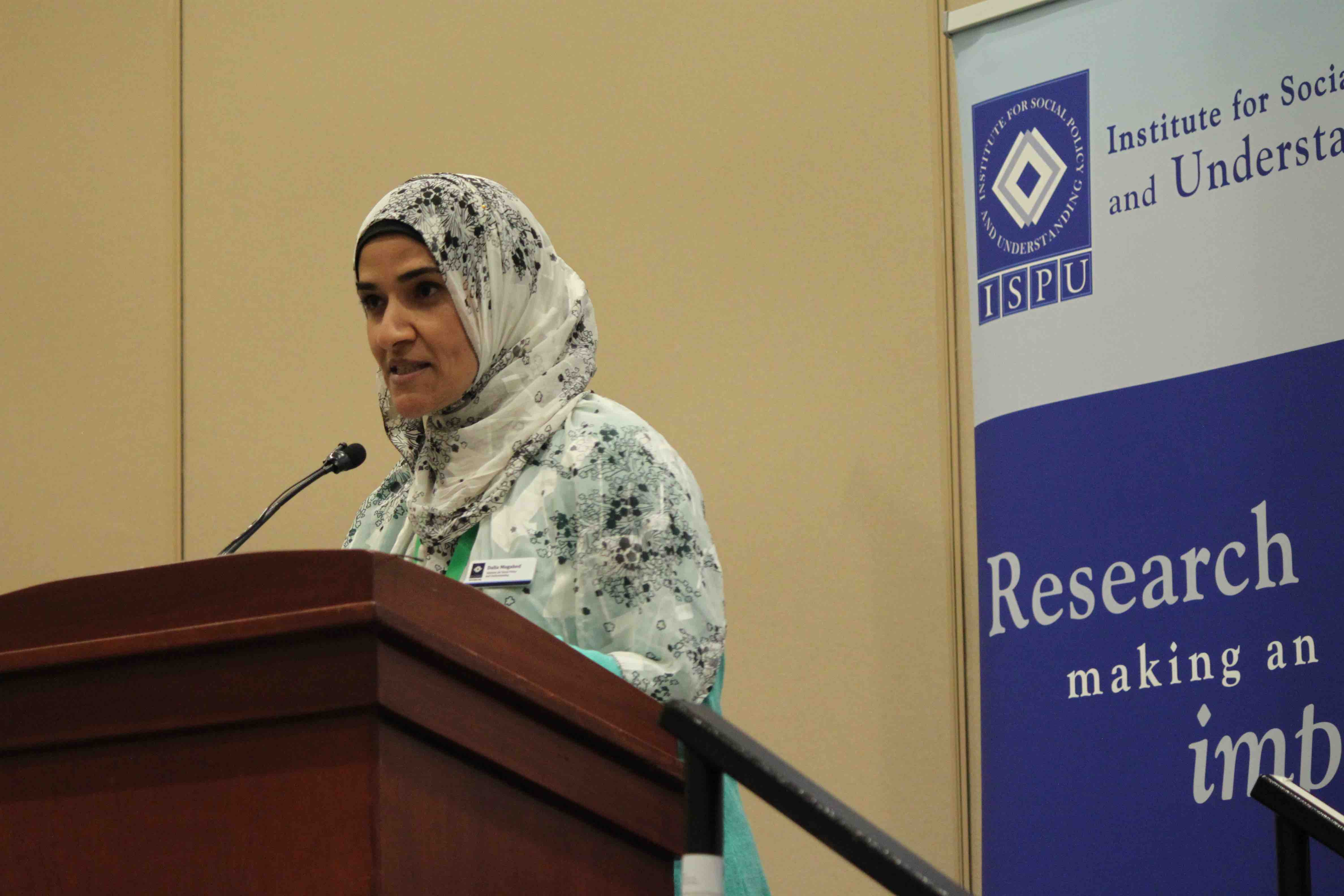 Dalia Mogahed speaking at a podium
