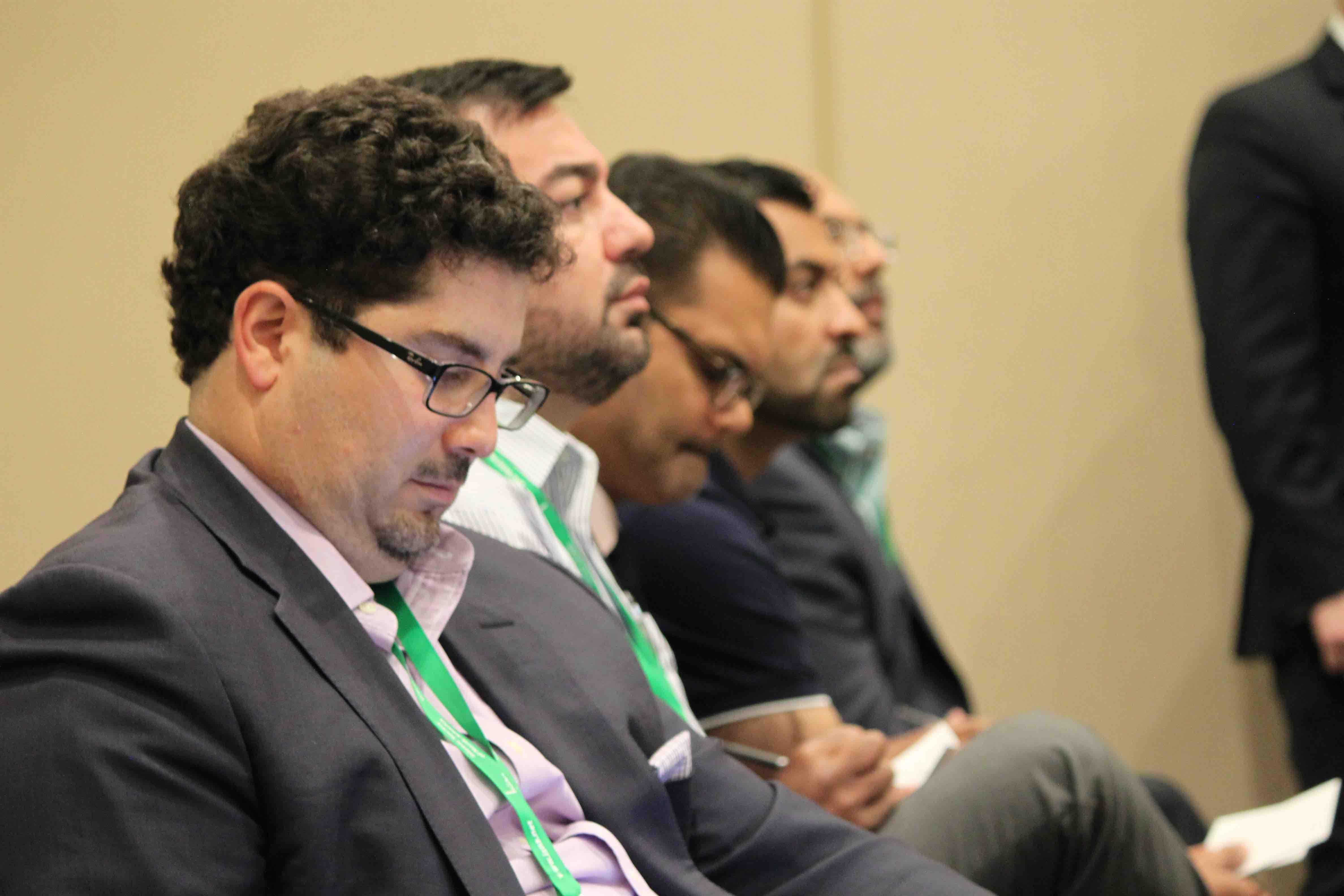 A group of men watching the debate