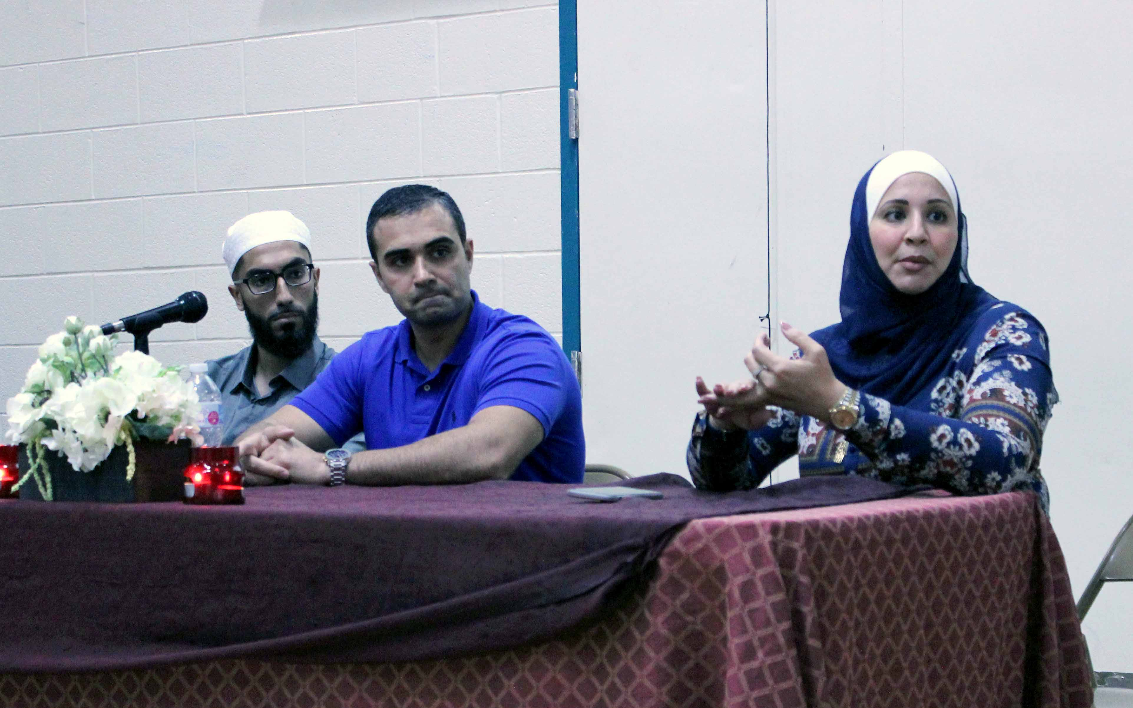 Panelists Ghufraan Akram, Ali Sayed and Suehaila Amen speak to a crowd at MCWS mosque