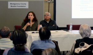 Executive Director Meira Neggaz speaking with a group of mostly seniors at the Montgomery County Muslim Foundation.
