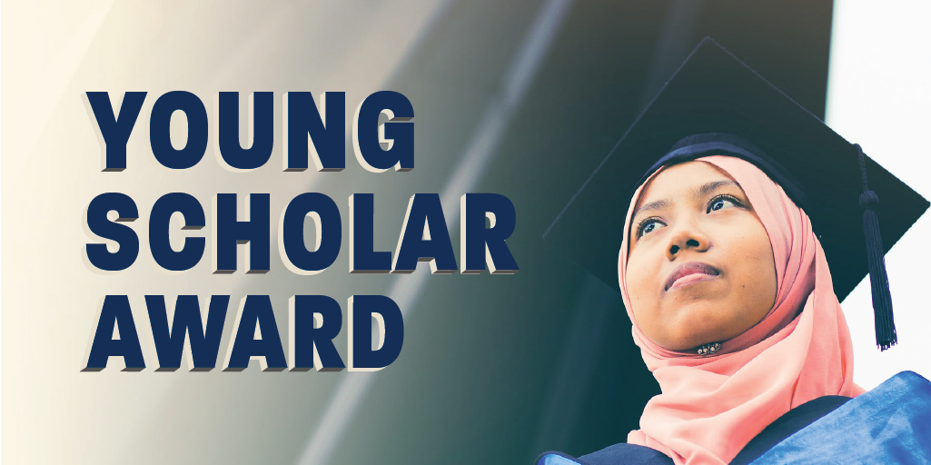Young Scholar Award - A young graduate wearing a pink hijab stares off into the distance