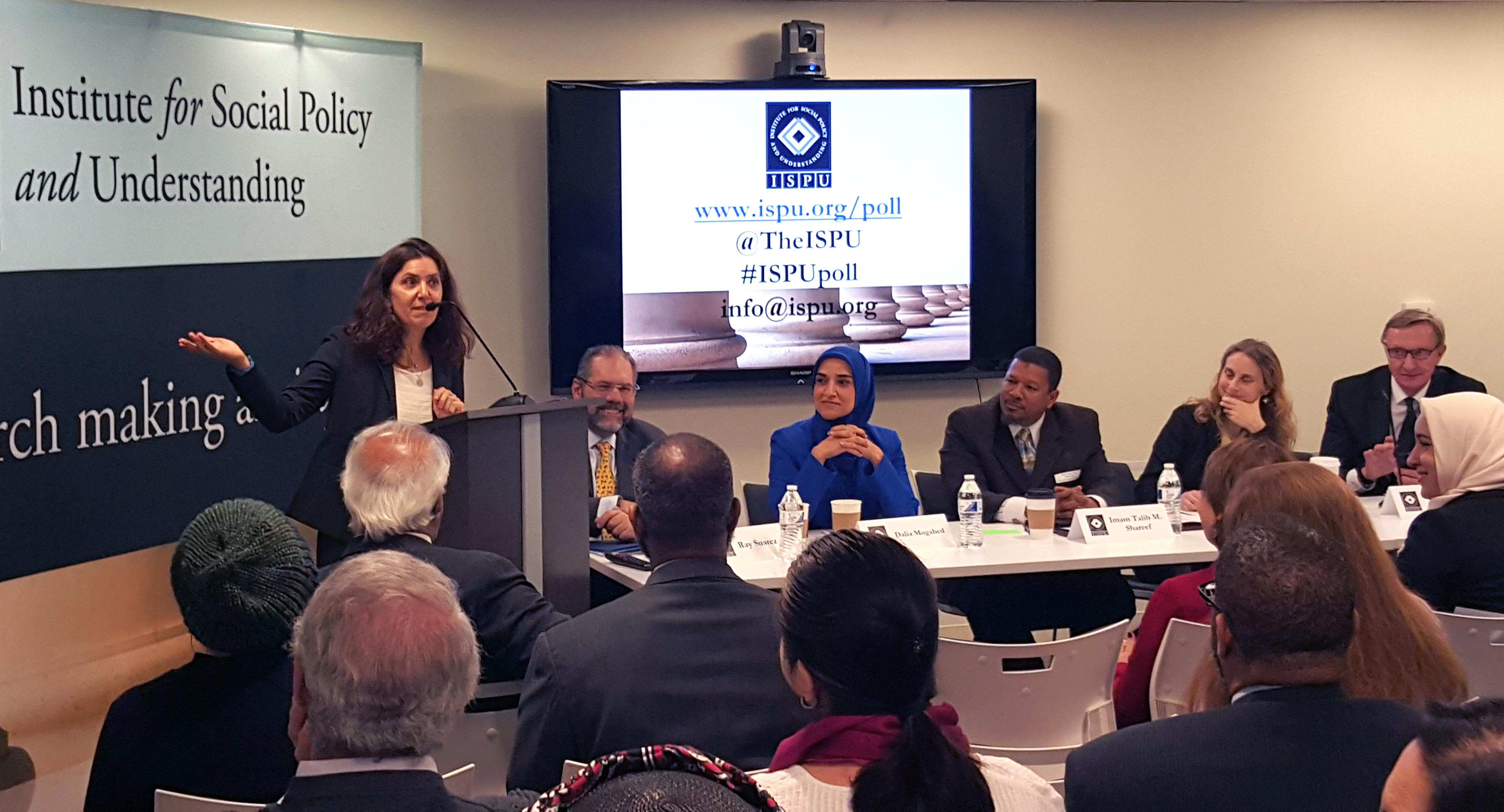 A group of presenters reveal the results of ISPU's first nationwide survey: American Muslim Poll 2016