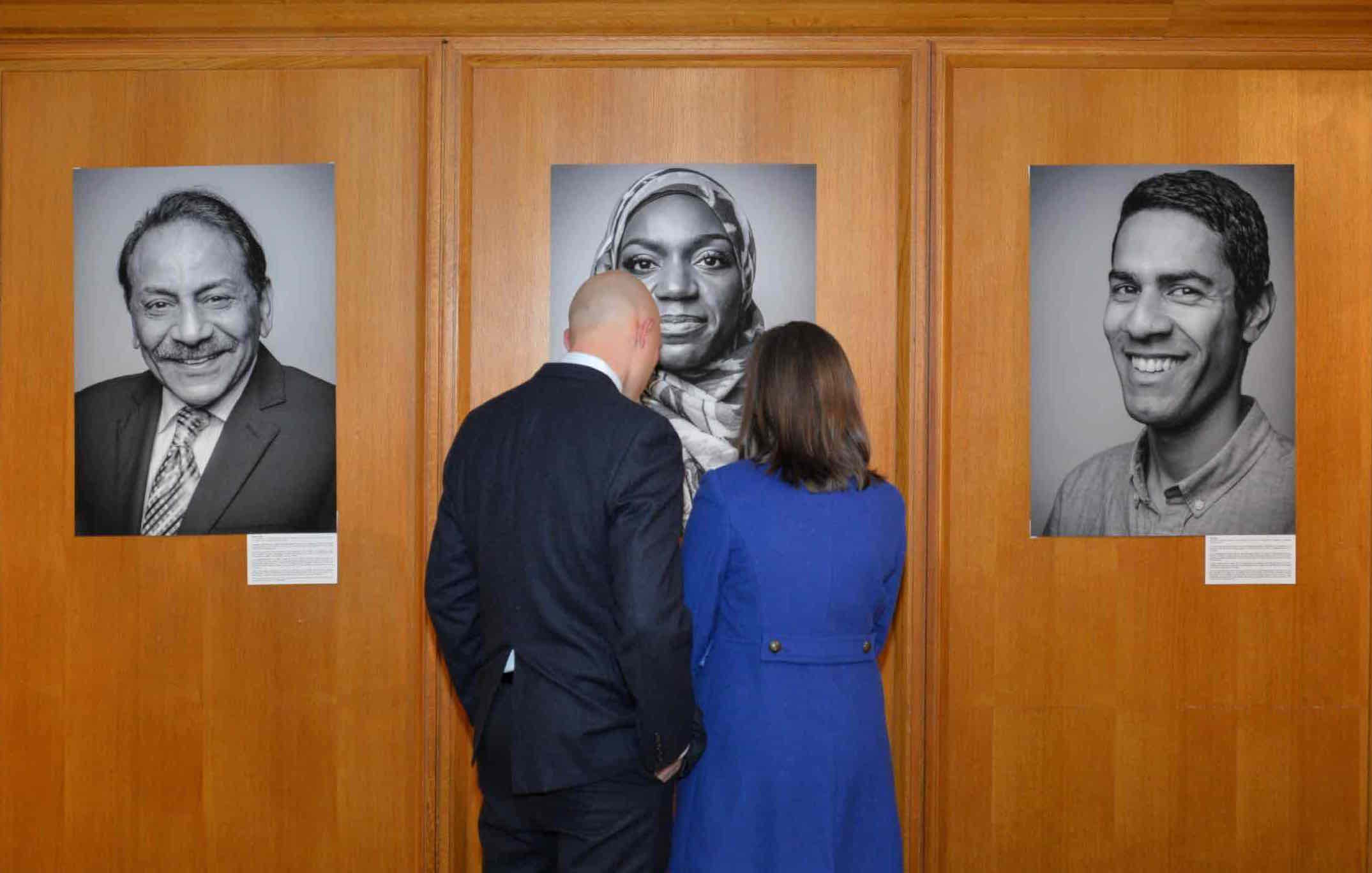 2 people looking at a photo narrative exhibit