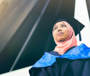 Malaysian student wearing graduation robes and hat