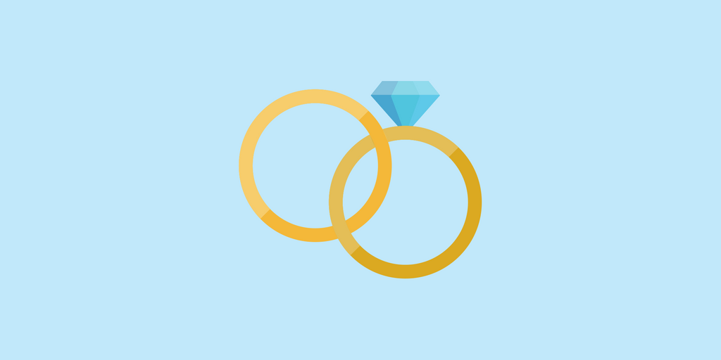 Two gold rings intertwined, one with a gem