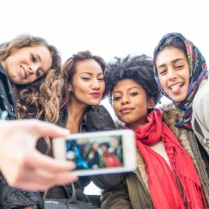 Group of attractive young women of different ethnics taking a selfie