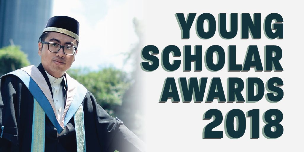 Young Scholar Awards 2018 - A young man in graduation gown and glasses