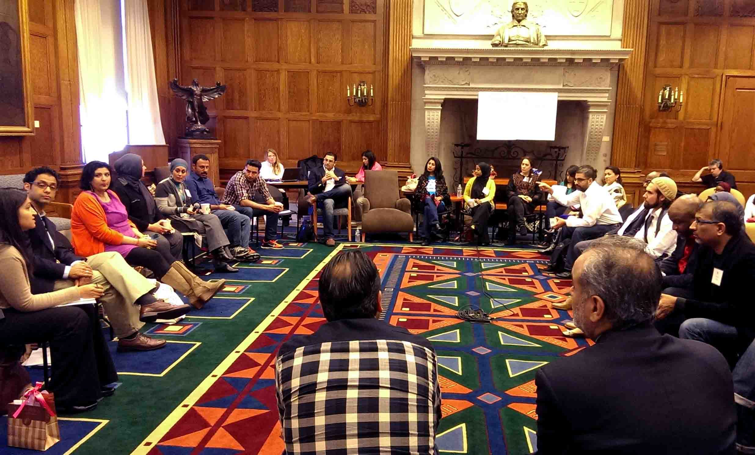 Attendees of the (Re)presenting American Muslim workshop sit in a circle discussing key topics