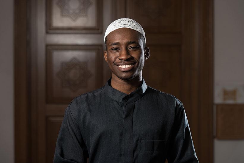 Young African American Muslim Man Wearing a Traditional Cap Dishdasha