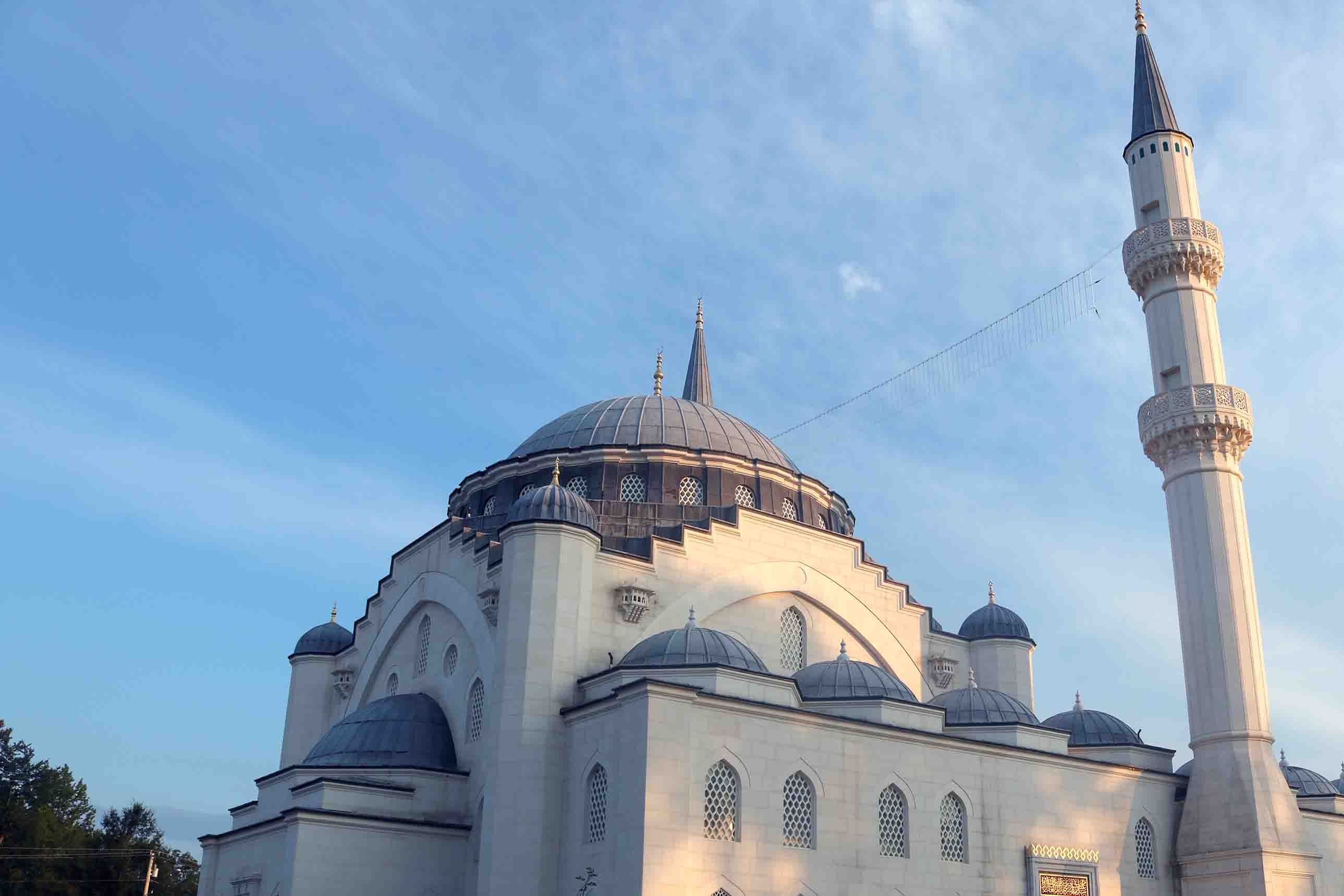 A grand mosque with a large blue dome