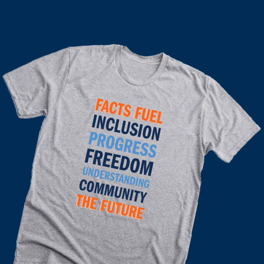 A heather gray t-shirt that reads FACTS FUEL INCLUSION PROGRESS FREEDOM UNDERSTANDING COMMUNITY THE FUTURE