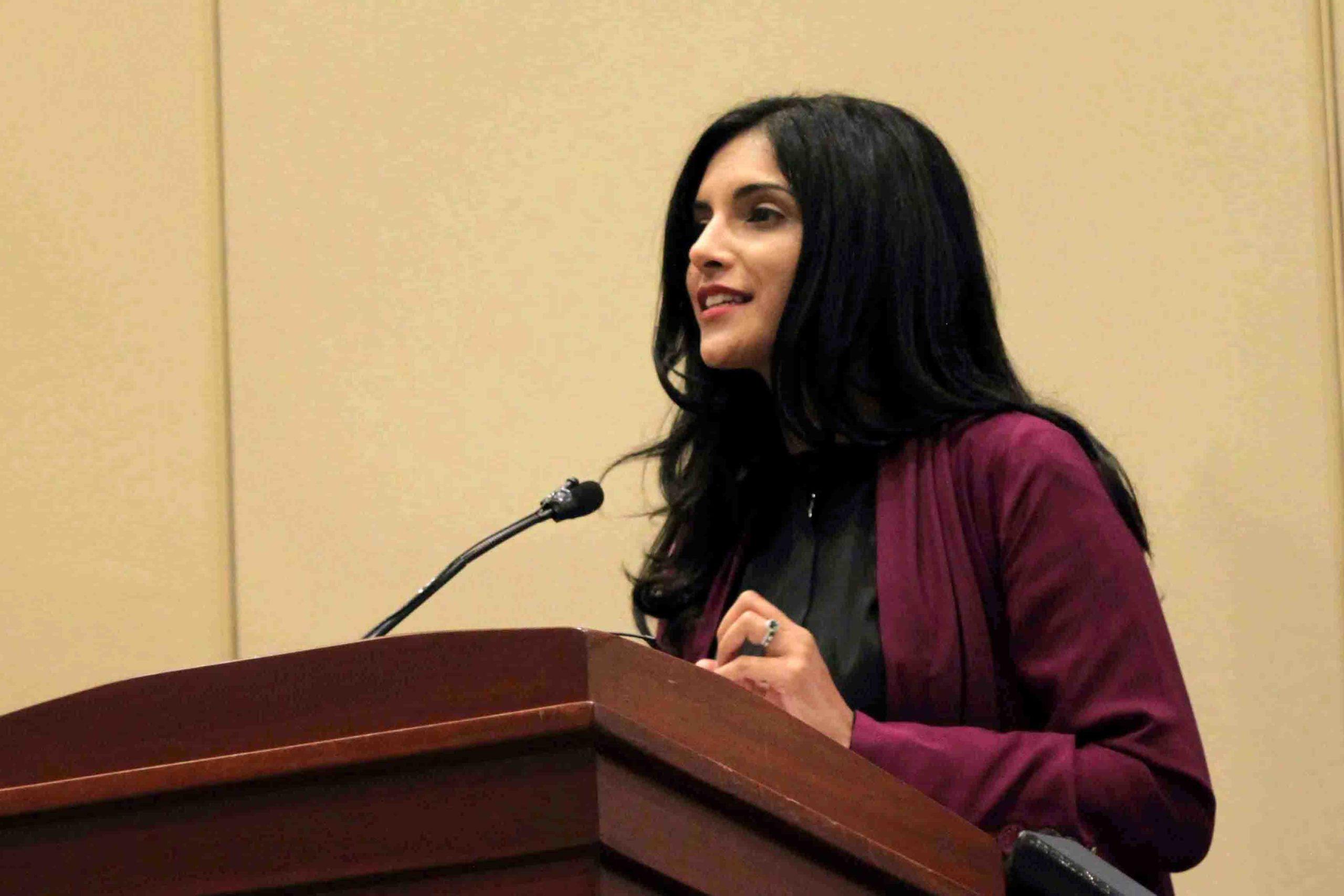Samar Kaukab at a podium debating engagement vs. boycott at the 2015 ISNA Convention