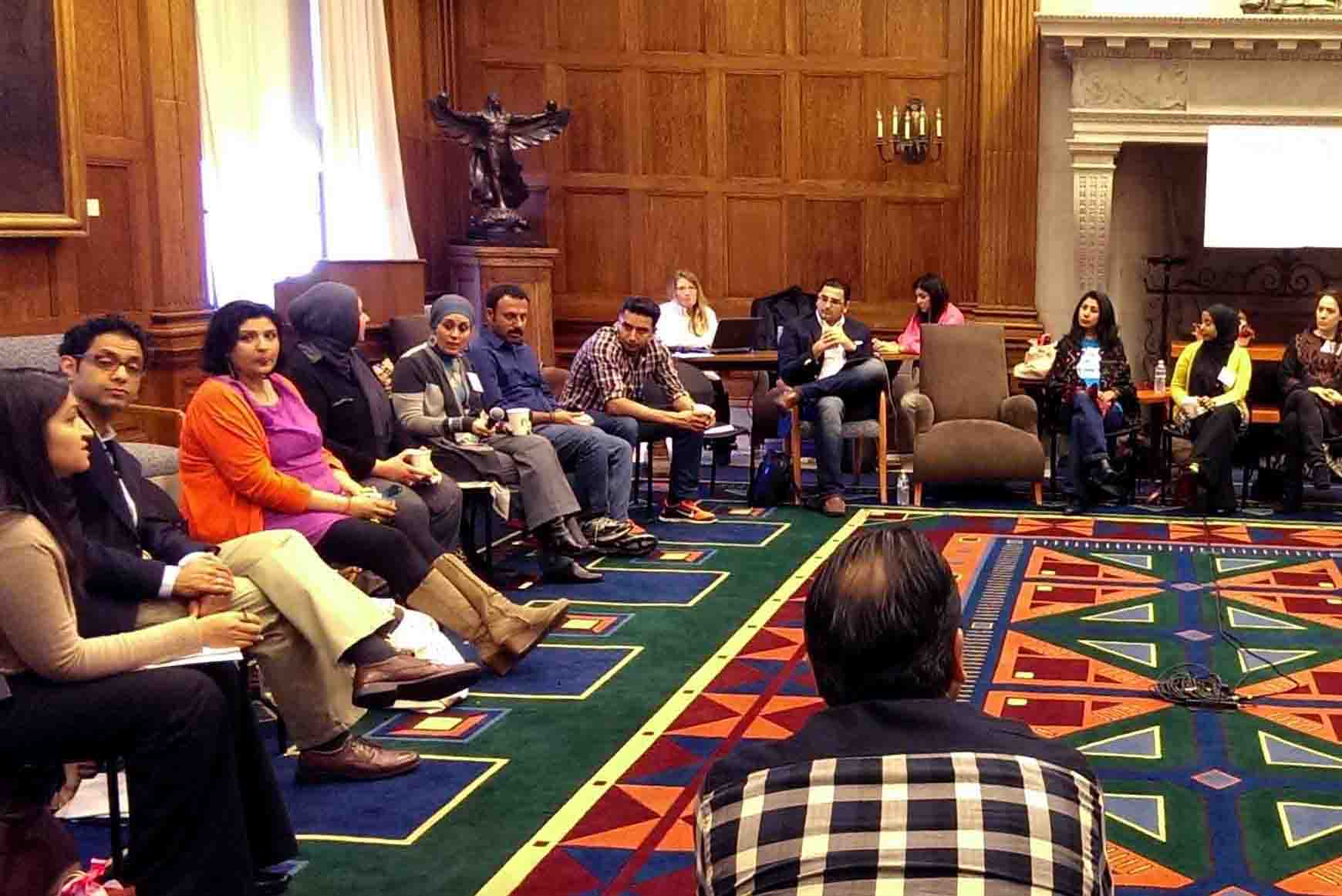 Workshop attendees sitting in a circle at Harvard University