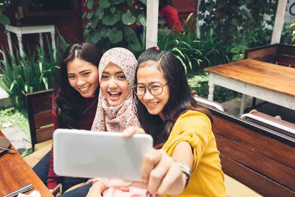 Three young women taking a selfie