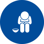 An icon of a person sitting and looking at the ground with an empty bowl next to them