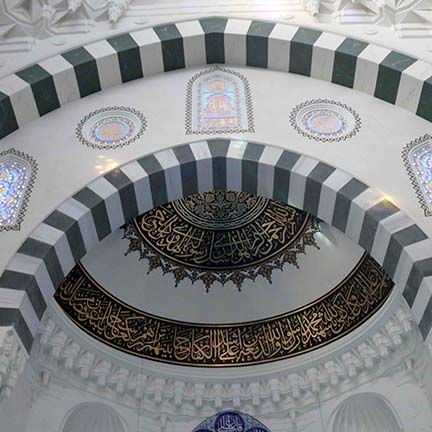 A beautifully and intricately painting ceiling of a mosque