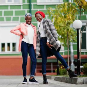 Two young, Black Muslim women posing and smiling
