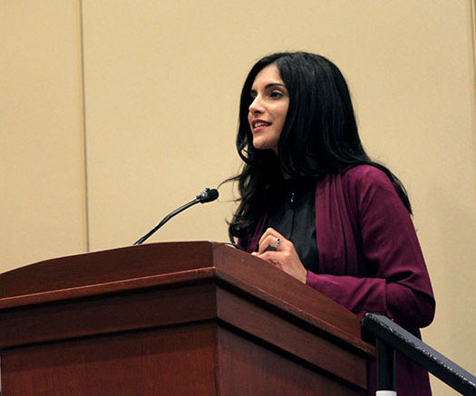 Samar Kaukab speaking at a podium