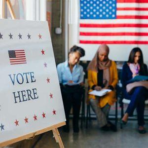 Diverse Voters Filling Out Registration Forms